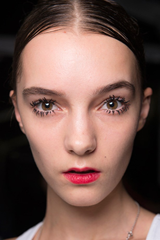 """<strong>Lashes<BR></strong> """"Miuccia Prada wanted clogged lashes,"""" says makeup artist Pat McGrath, who piled on """"tons and tons"""" of deep black mascara to achieve a cartoon-like lash look at the Prada AW14 show."""
