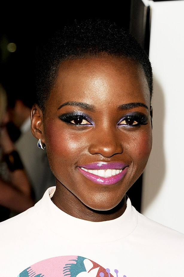 Nyong'o arrives at the <em>12 Years A Slave</em> premiere in L.A. back in October 2013 wearing metallic purple eyeshadow and a vibrant pink lip.