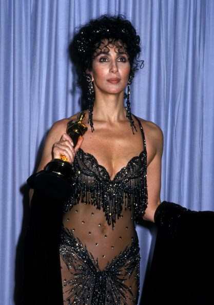 """<strong>Cher, 1988</strong><br> For her Best Actress win for Moonstruck Cher, dressed in a splashy Bob Mackie number, was unpretentious yet fantastically proud of taking home the award-  she owned it without being soppy. """"My mother told me to be somebody"""" she beings, before thanking her team and fellow nominees. """"This doesn't mean I am somebody, but I'm on my way."""""""