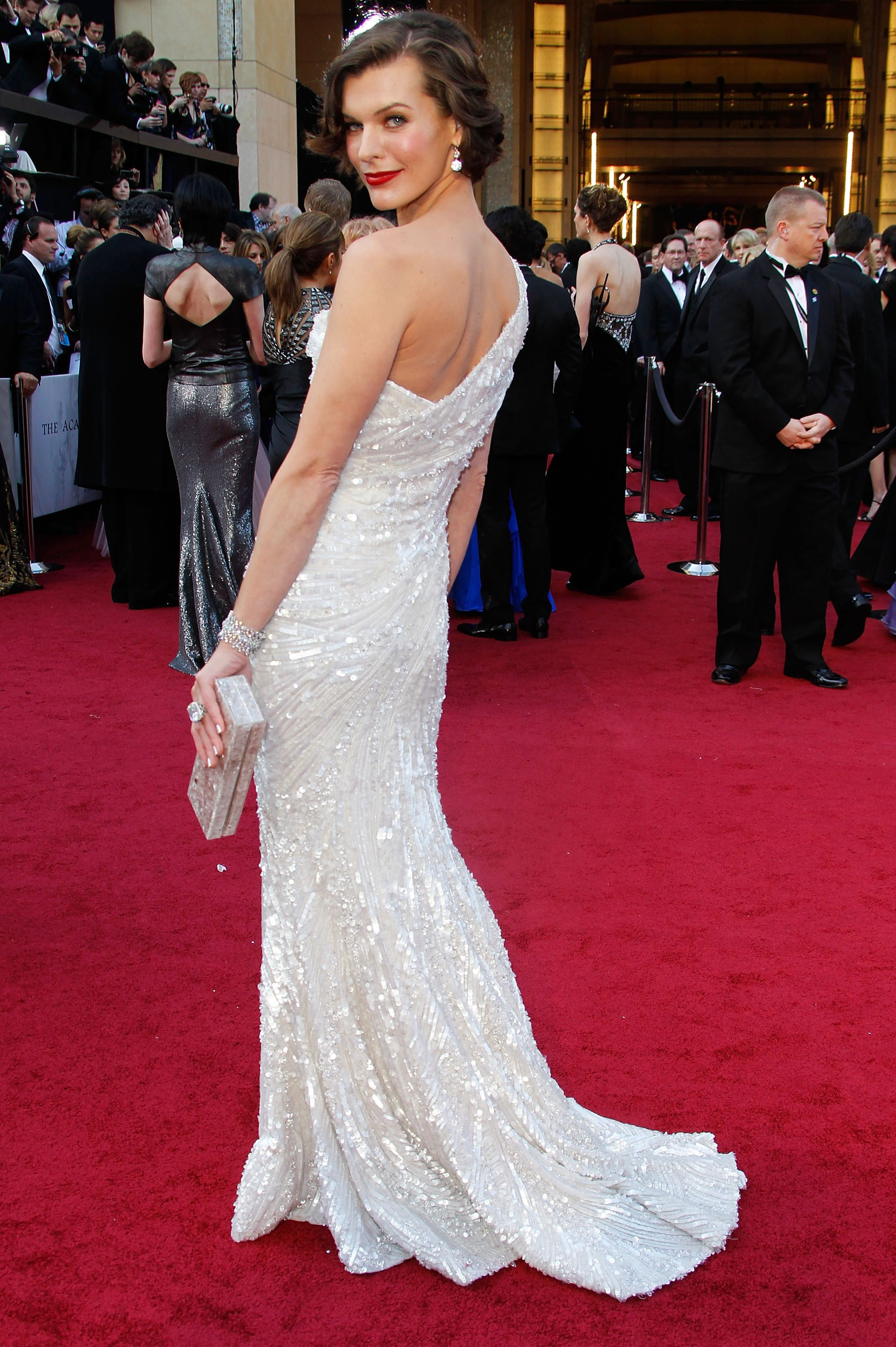 Milla Jovovich at the 84th Academy Awards, 2012, wearing Elie Saab Couture and Jacob & Co. jewellery.