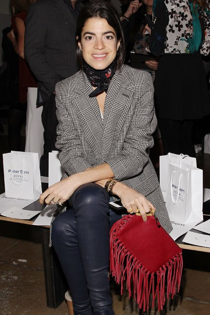 <strong>Who:</strong> Leandra Medine<br> <strong>Where:</strong> Peter Som at New York Fashion Week<br> <strong>Style lesson:</strong> A silk scarf wrapped around the neck is the accessory <em>du jour</em>. Choker necklaces will also do the trick.