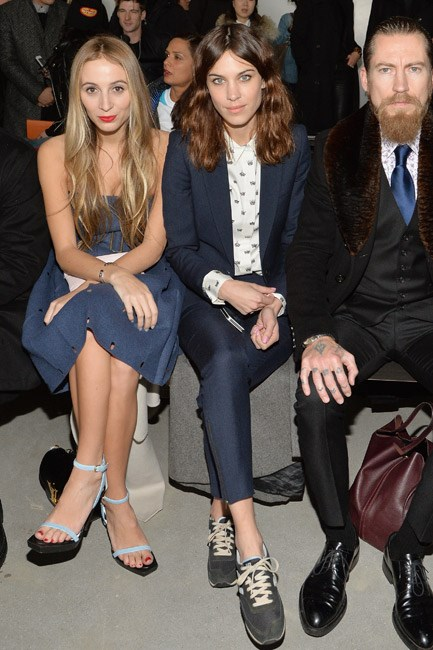 <strong>Who:</strong> Alexa Chung (pictured with Harley Viera-Newton and Justin O'Shea)<br> <strong>Where: </strong>Calvin Klein at New York Fashion Week<br> <strong>Style lesson:</strong> Mixing sneakers with a tailored suit is a great way to tread the line between channeling an uptown and downtown girl.