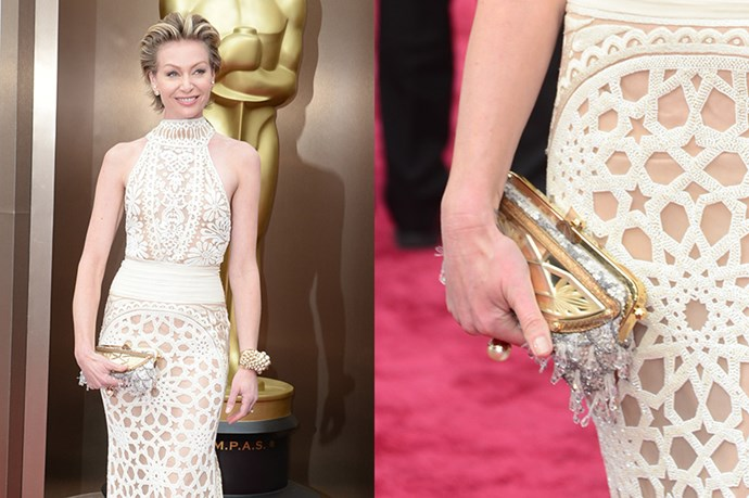 Portia DeRossi was one of the first stars to hit the 86th Annual Academy Awards - ready to support wife, and award's host, Ellen DeGeneres. DeRossi's intricate clutch purse, and pearl-encrusted cuff were the perfect partner for the star's ivory Naeem Khan gown.