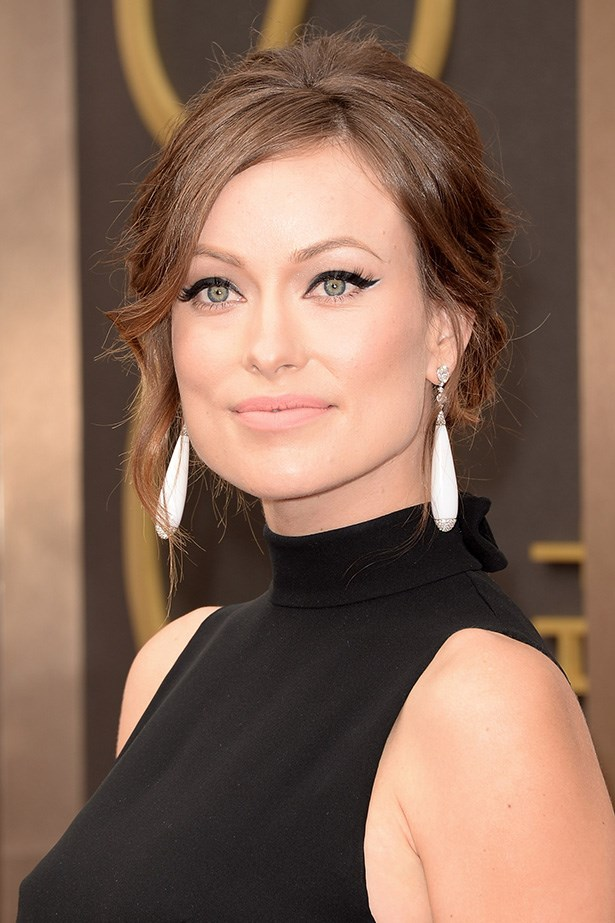 Pregnant Olivia Wilde opted for dramatic false lashes, and a new take on liquid eyeliner, highlighted with a flick of white eye-pencil. The star finished her look with a nude lip.