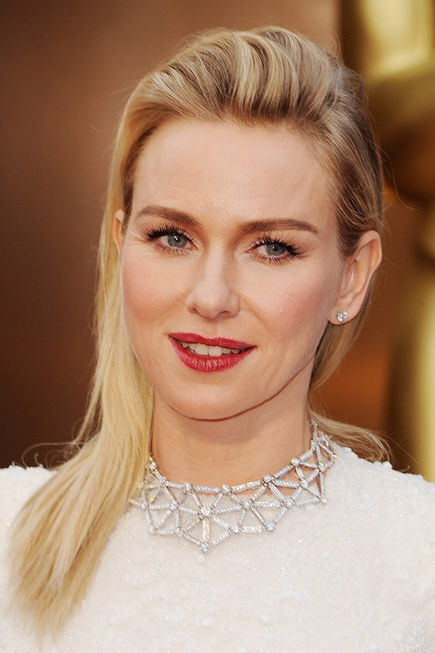 Naomi Watts is a red carpet knock-out with her hair elegantly swept back, accentuating her mascara-loaded fluttery lashes and red lip.