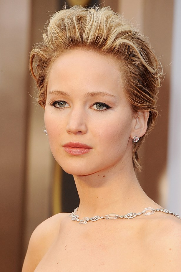 Dior's ambassadress and Oscar nominee, Jennifer Lawrence paired her red Dior dress with cats-eye liquid liner and a rosy lip. Her short hair was swept back - reminiscent of Sharon Stone's red-carpet style in the '90s.