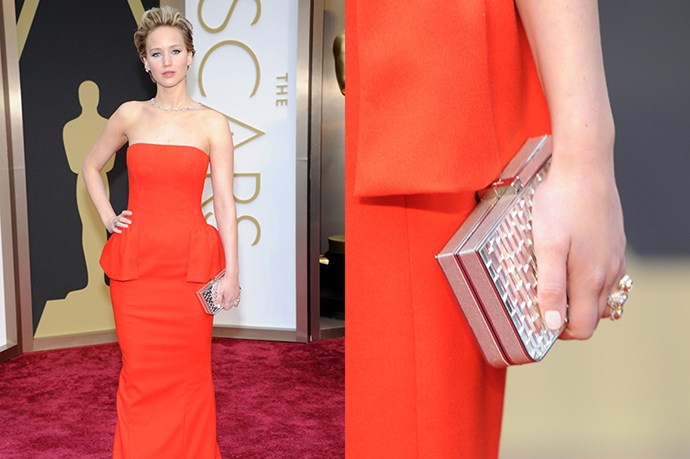 Oscar nominee, and face of Dior, Jennifer Lawrence carried a simple silver square box-clutch on the red carpet. The <em>American Hustle</em> star kept her wrists bare, accessorising with a few rings and an elegant backward necklace - similar to the necklace she wore at last year's awards.