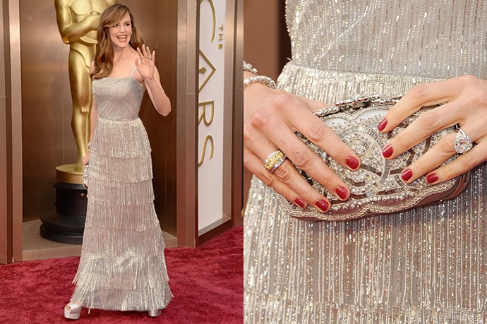 Jennifer Garner presented an award at the Oscars this year wearing an Oscar de la Renta fringed gown. The star aptly chose an intricately embroidered clutch purse, yellow-diamond cocktail ring and multiple diamond tennis bracelets.