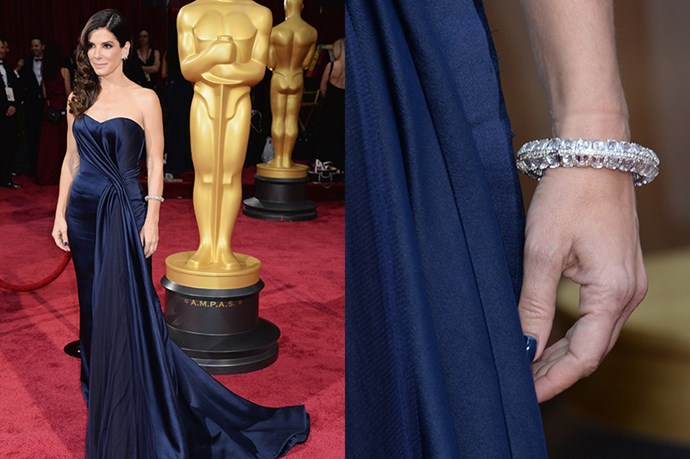 Oscar nominee Sandra Bullock ditched a clutch in favour for a simple Lorraine Schwartz diamond bangle.