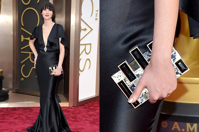 Karen O looked glamorous in a diamond trifecta - brooch and bracelet by Neil Lane and Stephen Webster for Forevermark with a bejeweled Rau Wolf clutch.
