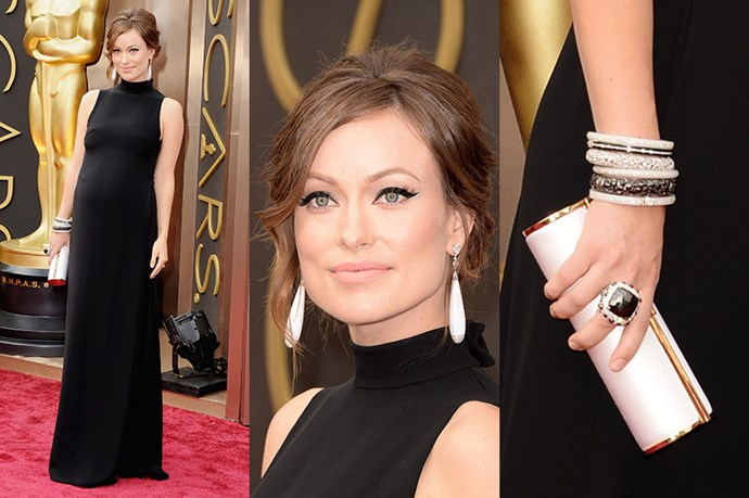 Pregnant Olivia Wilde kept things monochrome in a Valentino dress, white Lorraine Schwartz drop earrings and a matching clutch.