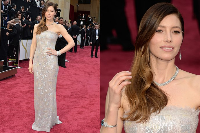 Dripping in diamonds, Jessica Biel walked the (soggy) red carpet decked out in Tiffany & Co. diamonds including topaz-drop earrings, a tropez Art Deco cuff and and breathtaking diamond necklace.