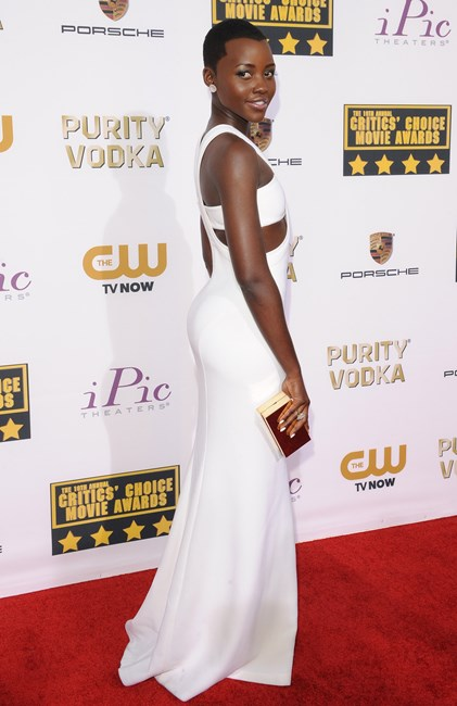 Lupita Nyong'o wearing a Calvin Klein Collection gown and clutch at the Critics' Choice Movie Awards 2014