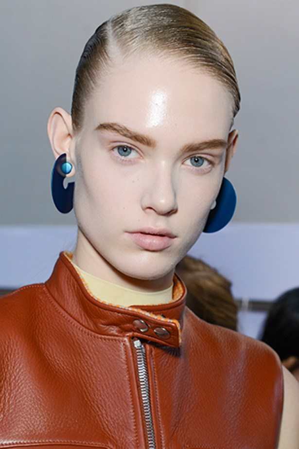 "<strong>Natural part-deux<BR></strong> Makeup artist Aaron de Mey gave his androgynous Acne girls ""face-lights"" by applying M.A.C's clear Lipglass ($35, <a href=""http://maccosmetics.com.au"">maccosmetics.com.au</a>) to cheekbones and chins."