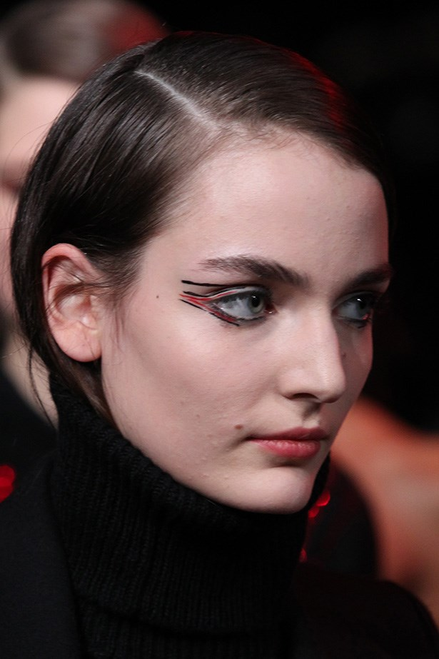 "<strong>Culture kid<BR></strong> Estée Lauder creative makeup director Tom Pecheux was on hand at Anthony Vaccarello to illustrate eye makeup (read: application on a new level), using a combination of liquid eyeliner  and Pure Color Envy Sculpting Lipstick in Envious ($50, esteelauder.com.au). He said after the show, ""I created a makeup look in the style of graphic fashion illustrations, with ultra-fine lines of black and red to accent the eye…"""