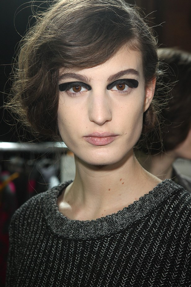 "<strong>Retro 'do<BR></strong> The faux bob at Dries Van Noten was a nod to the '40s. McKnight devised the vintage look by anchoring the turned-under hair with a braid, using texturising products to create the ""Veronika Lake"" style."
