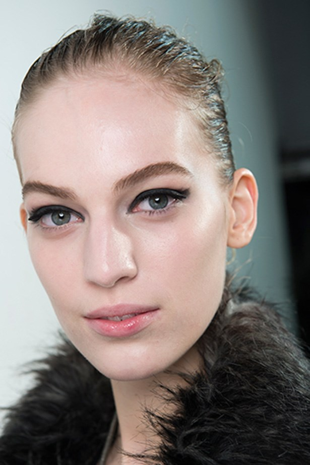 <strong>Heavy-on<BR></strong> McGrath presented a new-take on the smoky cat-eye, using a graphic and smudgy eye for the Lanvin AW14-15 catwalk. Cream-based black eyeliner was painted in textured brushstrokes and eyelashes were trimmed into square shapes.