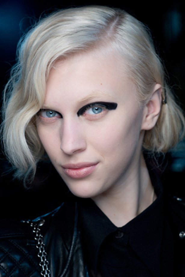 "<strong>Heavy-on<BR></strong> Makeup artist Peter Philips designed black, blocky eyeliner for Dries Van Noten's show. The heavy line curved with the model's eye creating ""the feeling of being done in one motion""."