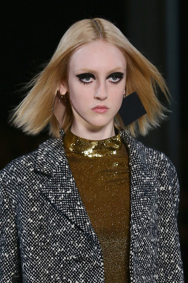 <strong>Heavy-on<BR></strong> YSL makeup artists created the ultimate homage to the '60s bad-girl. Cloggy mascara, faux-lashes and an exaggerated cat-eye hit three AW14-15 trends in one look.