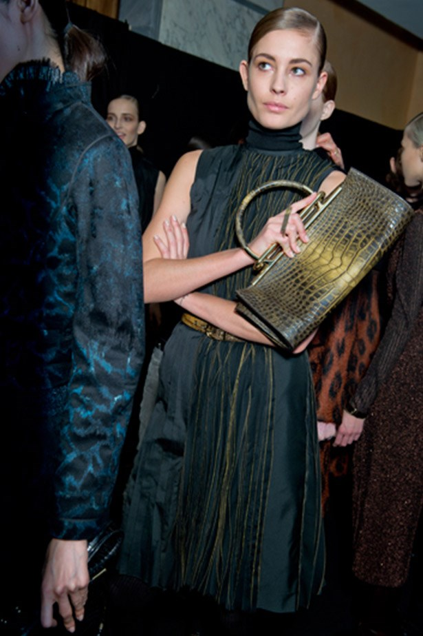 Handheld croc clutches at Salvatore Ferragamo.
