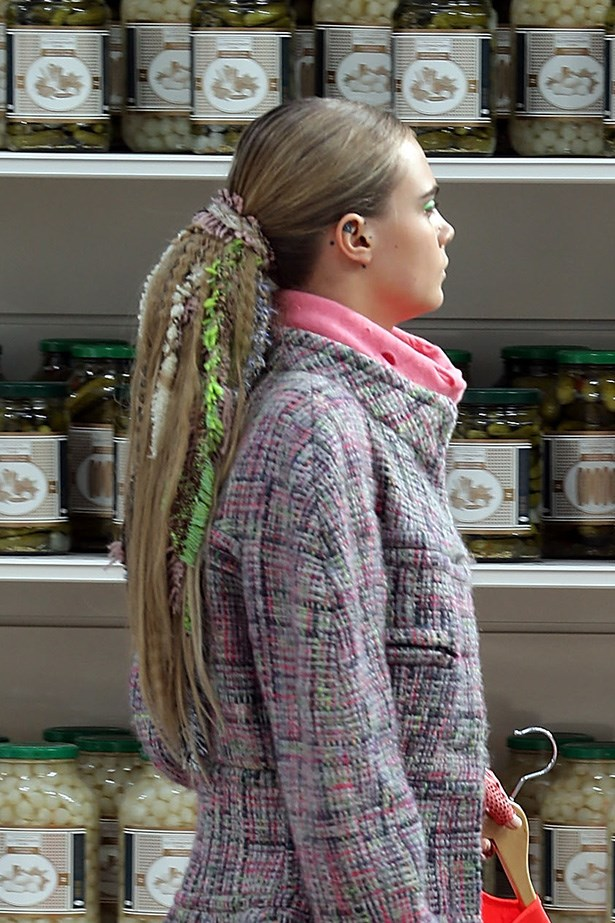 "<strong>Culture kid<BR></strong> Sam McKnight was on-hand at the Chanel supermarket-runway to give Cara Delevingne and Lindsey Wixson exaggerated ponytails, complete with tweed dreads using salt spray – reggae-meets-Coco. McKnight explained, ""[I] incorporated crimped extensions, braided hair in multi-coloured Chanel tweed rags, lace and pearls."""
