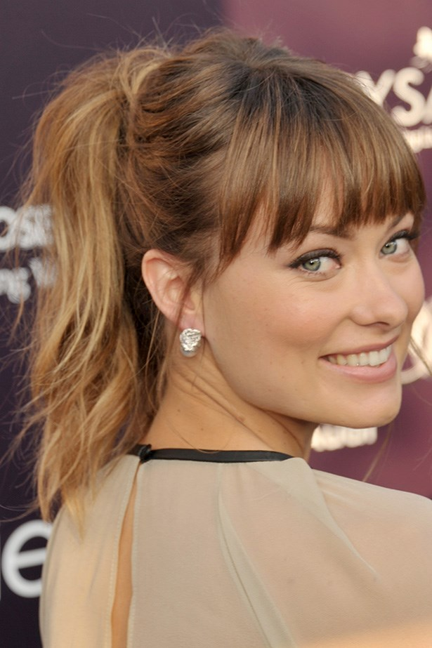 Sporting a blunt fringe and playful ponytail, Wilde looks effortlessly chic at charity ball in LA in 2011.