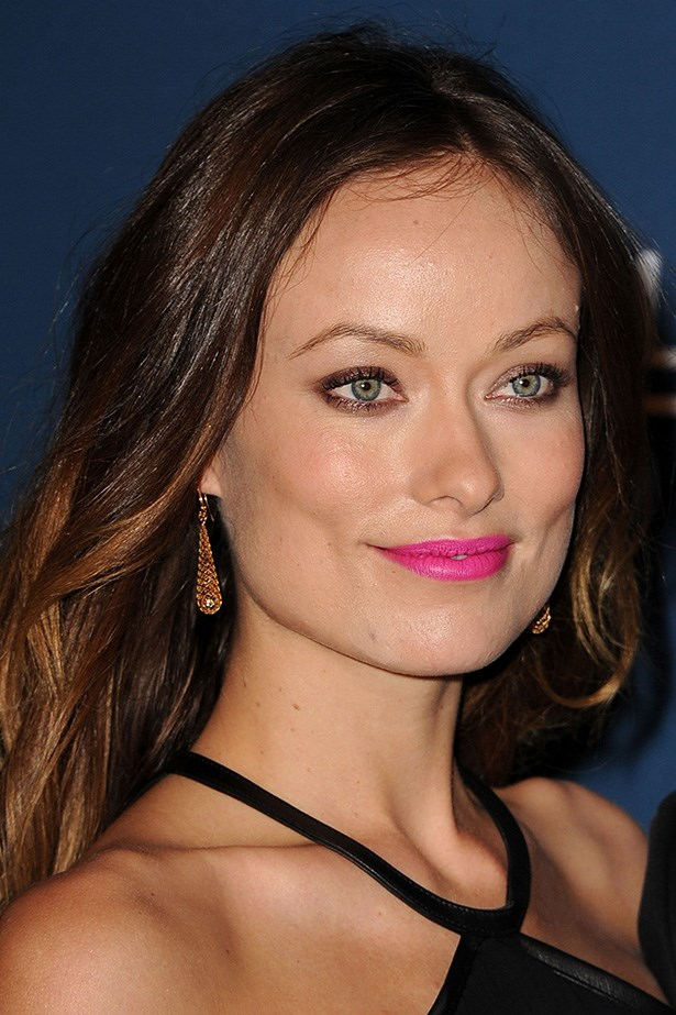 Low-key beachy hair and a punchy fuchsia lip at an industry gala last year.