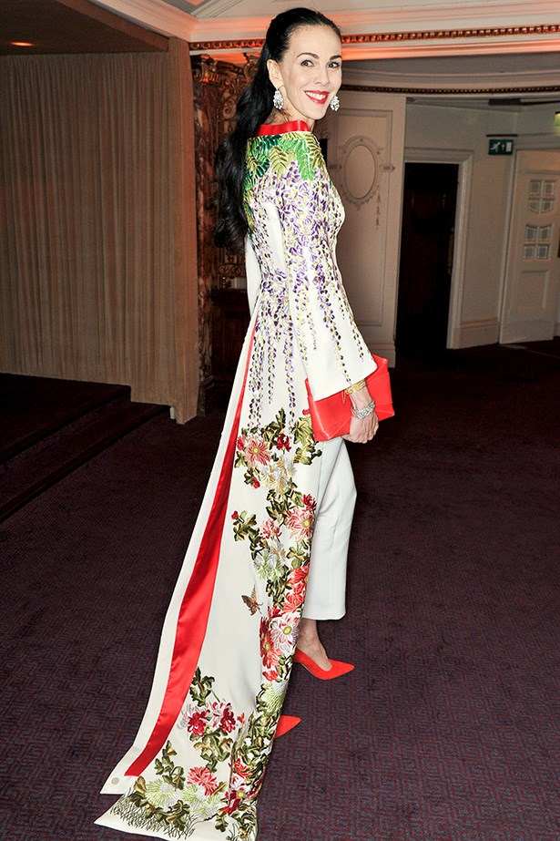 The designer attended the 2013 British Fashion Awards wearing an ornate, floor-length tailed-coat complete with red accessories.