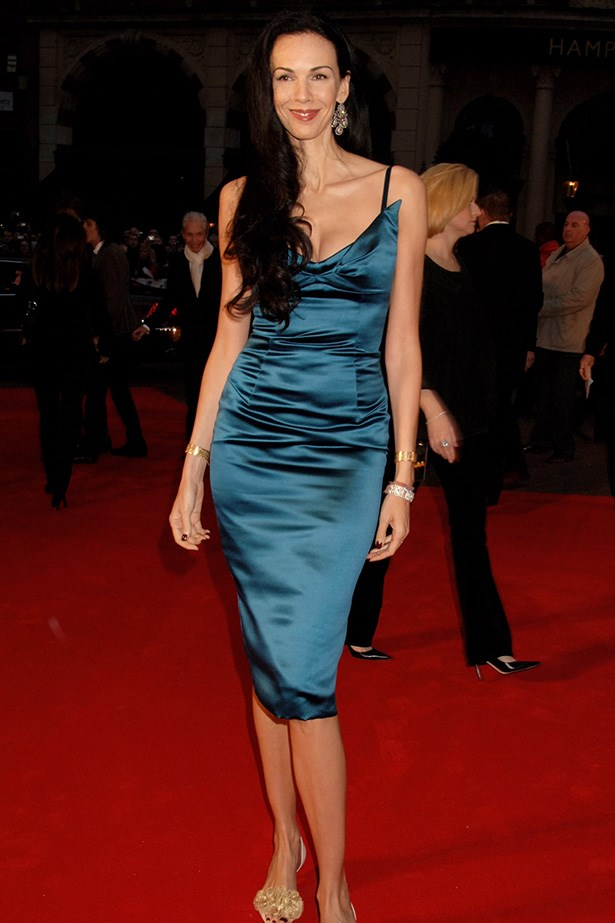 """The 6'4"""" model wore one of her namesake label's vampy, form-fitting designs to the <em>Shine a Light</em> premiere in London."""