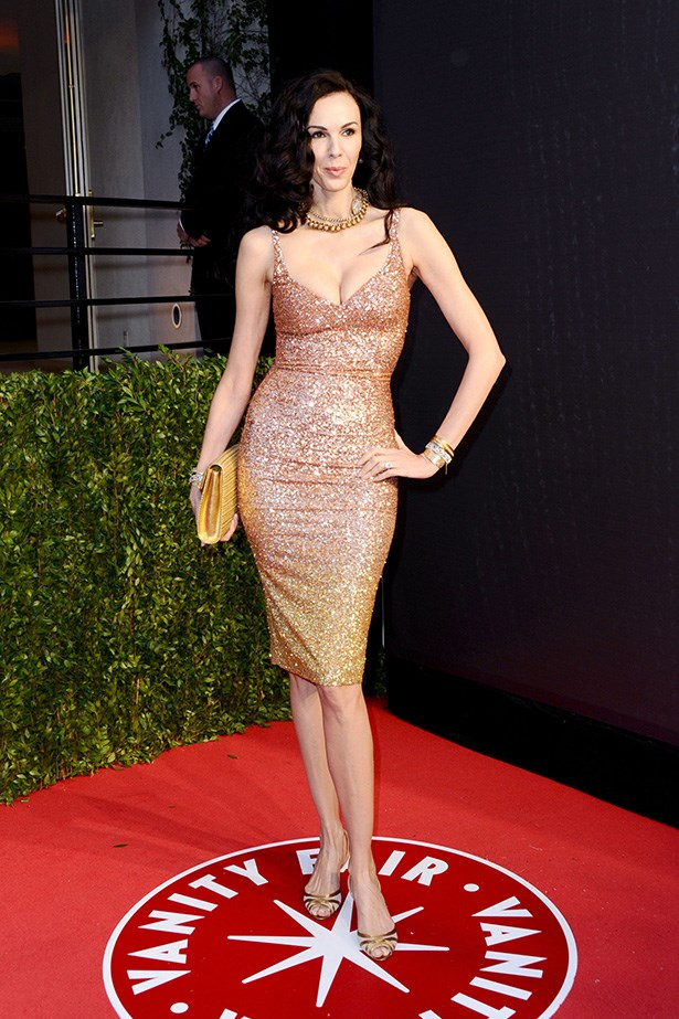Walking the 2011 Vanity Fair Oscar party red carpet, Scott looked incredible in a figure-hugging, spangled dress of her own design.