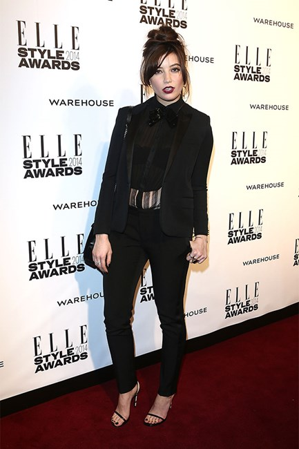 Daisy Lowe at the Elle style awards wearing pantsuit and dark lips