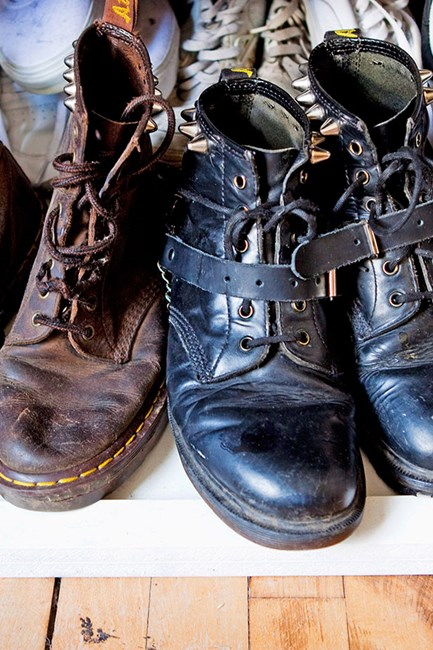 Cooney's collection of sturdy boots ground her offbeat wardrobe
