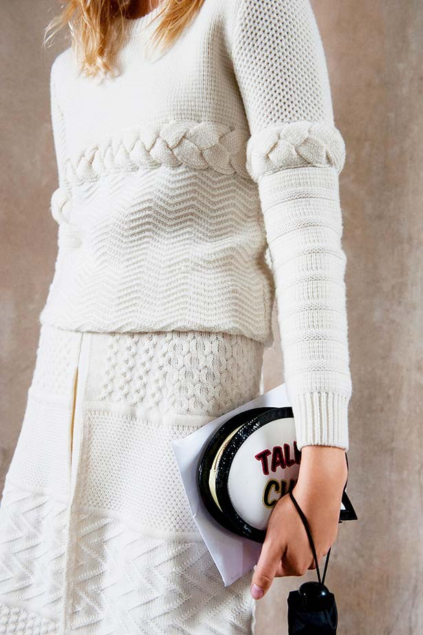 """""""Cable knits get a modernist makeover with this neat sweater and skirt combo. Great cheeky bag, too."""""""