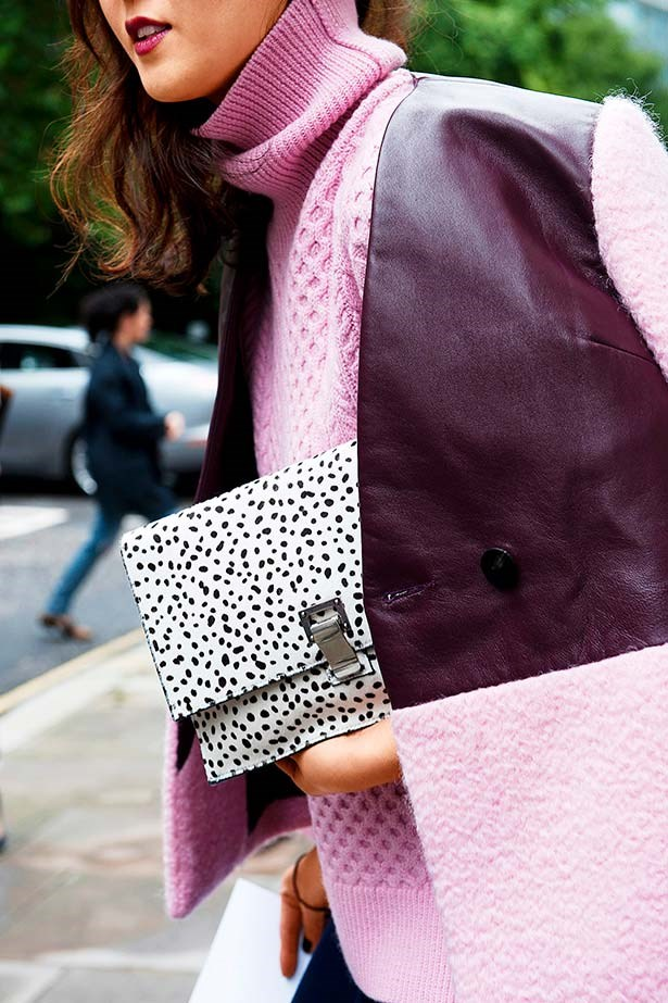 """""""I'm generally quite terrified of colour but I'd make an exception for this dreamy pink sweater and leather -panelled jacket. The ocelot-print clutch is a cute little bit on the side."""""""