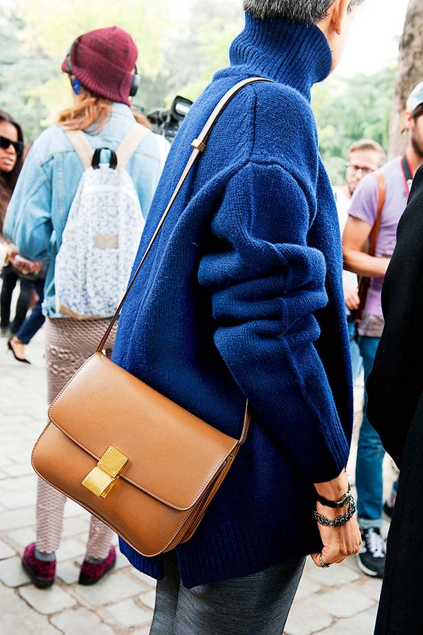 """""""Who needs an of-the-moment, head-to-toe, just-seen-on-the-catwalk, crazy fashionista outfit when a luxe navy sweater and camel Céline bag screams understated chic so much louder?"""""""