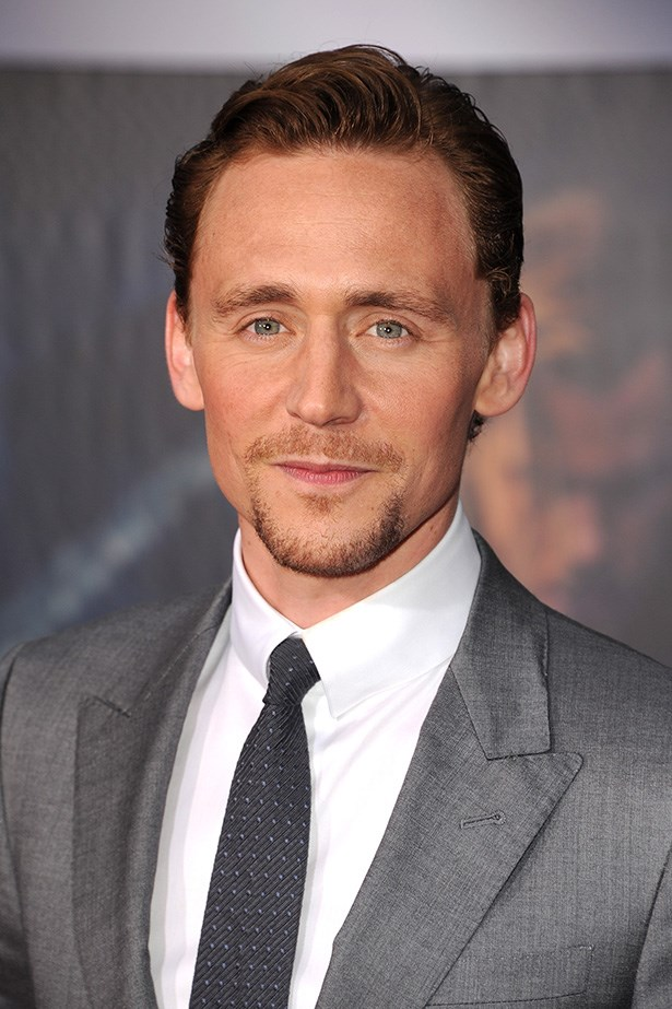 Tom Hiddleston looking dapper in a grey suit