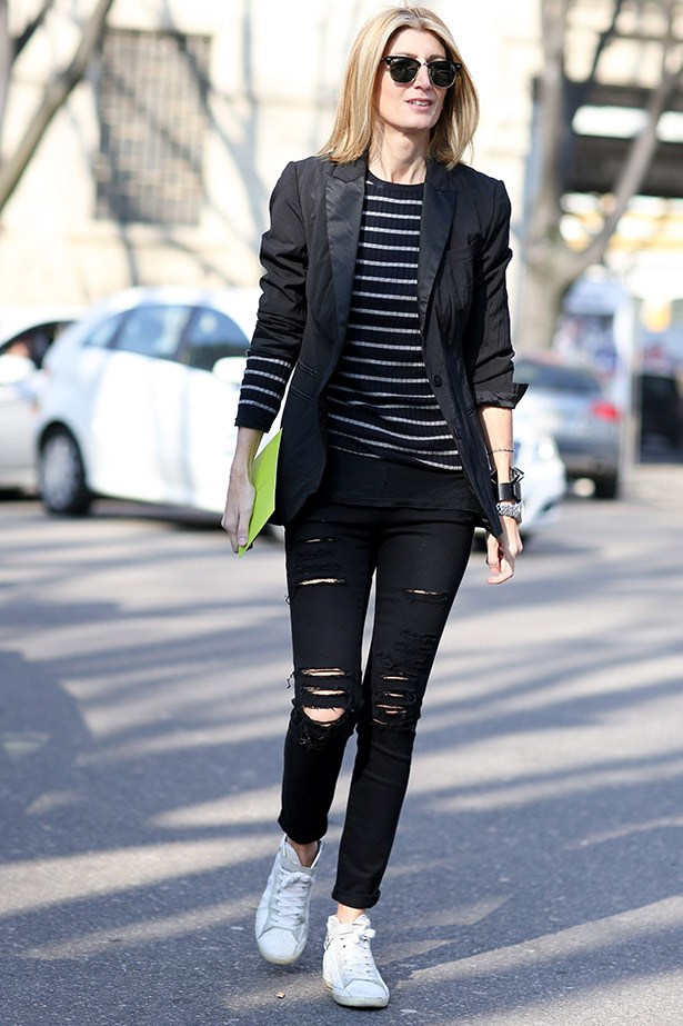 Spin a tuxedo jacket for the weekend with ripped up jeans and sneakers.