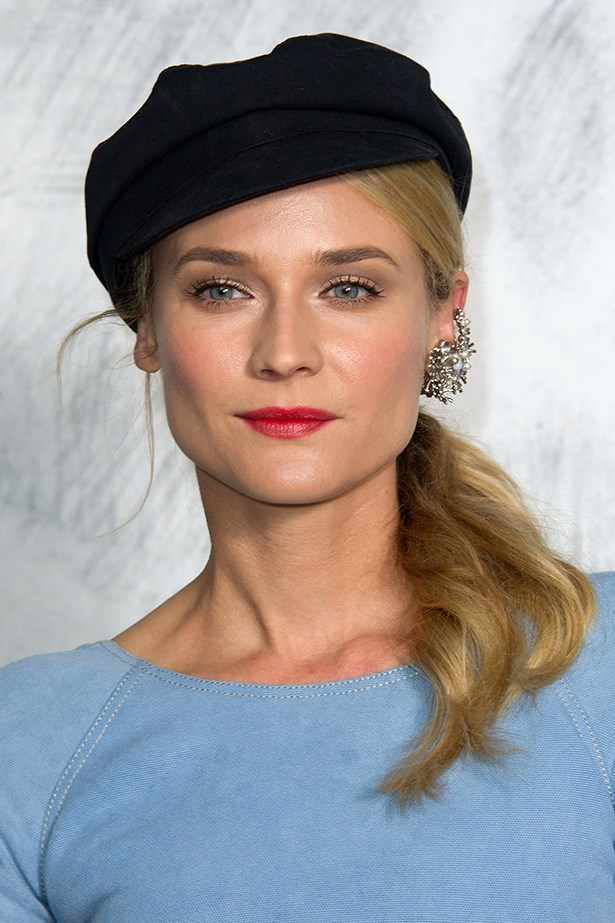 Diane Kruger looks like a Parisian dream in her statement ear piece, polished off with a red lip and beret.