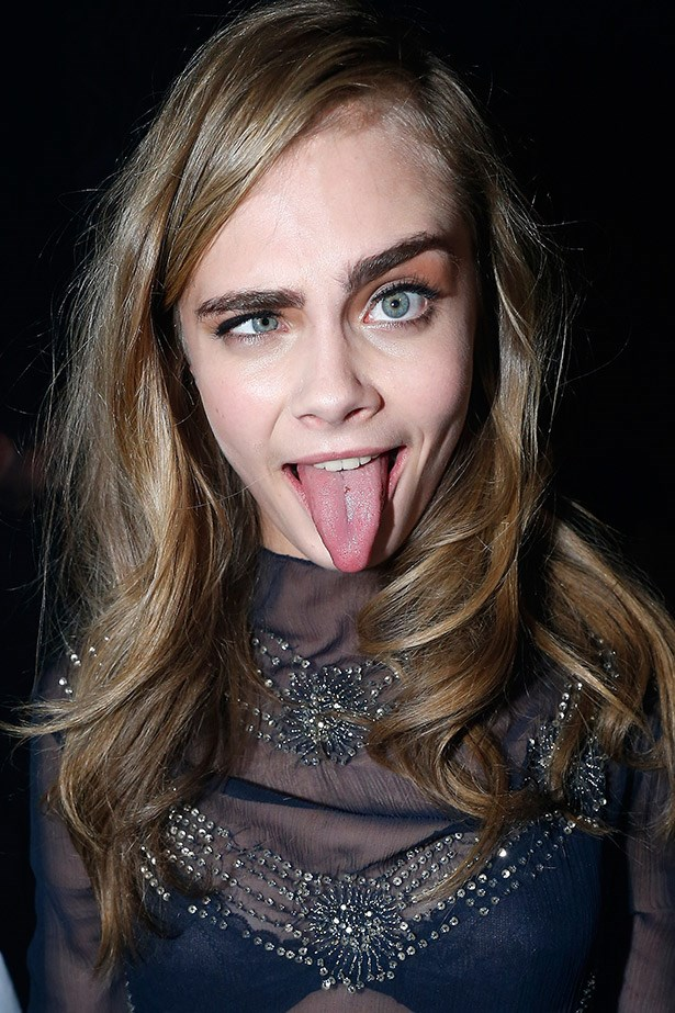 Cara Delevigne up to her elastic-face tricks.