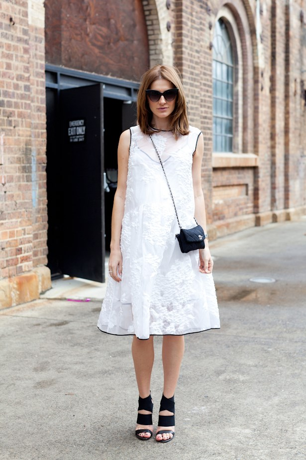 Kate Waterhouse keeps things pretty in an Erdem dress, cat-eye sunglasses and Chanel bag