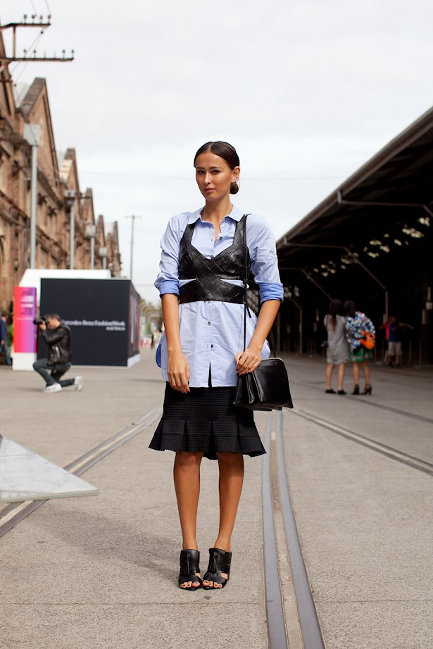 Eleanor Pendleton wears a denim skirt with a leather harness and Céline Trio bag.