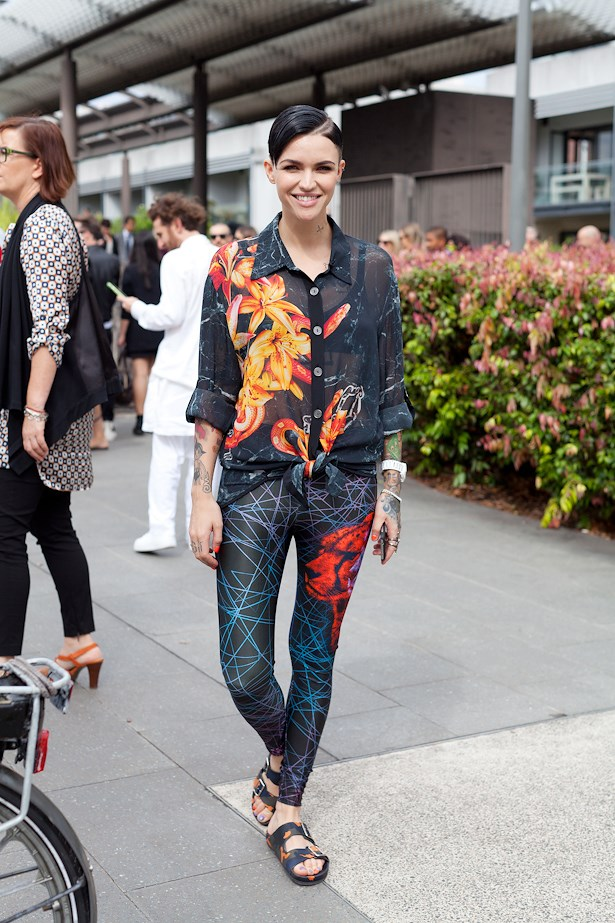 Ruby Rose wearing We Are Handsome shirt and leggings with Givenchy flats.