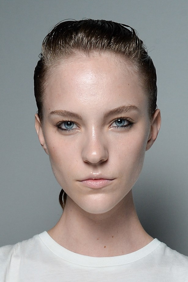 The wet look ponyrail at Carla Zampatti was a new take on the flat top - with a gentle rise through the front.