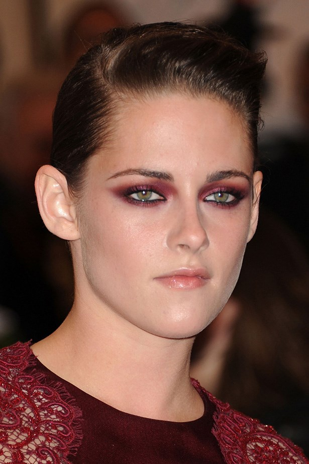 """A poster-girl for the 2013 Met Ball's """"PUNK: Chaos to Couture"""" theme, Stewart wowed the red carpet with dramatic burgundy eyeshadow and sleek up-do."""