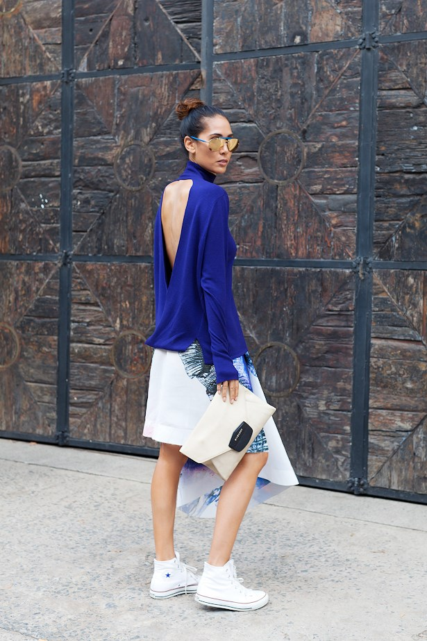 Lindy Klim wears Dion Lee knit and skirt with Converse.