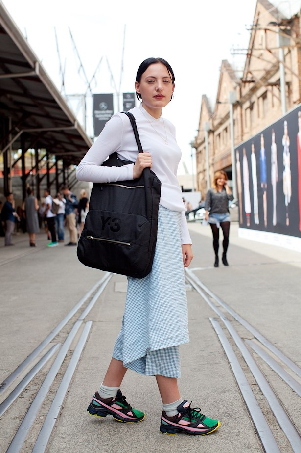 Marcelle wears Uniform top, Comme Des Garcon apron, Raf Simons sneakers and Y3 bag.