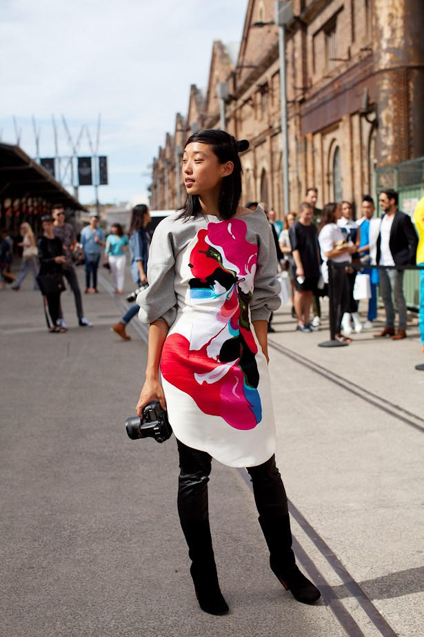 Margaret Zhang wears Haryono Setiadi dress, White Suede sweater and Givenchy boots.