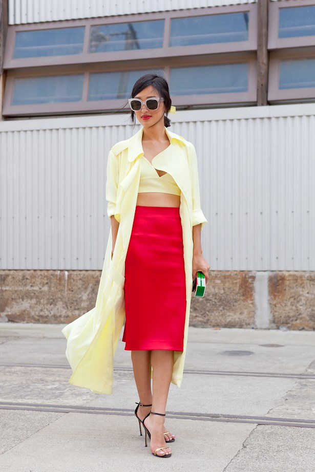 Nicole Warne wears Michae Lo Sordo jacket, crop and skirt with Charlotte Olympia clutch.