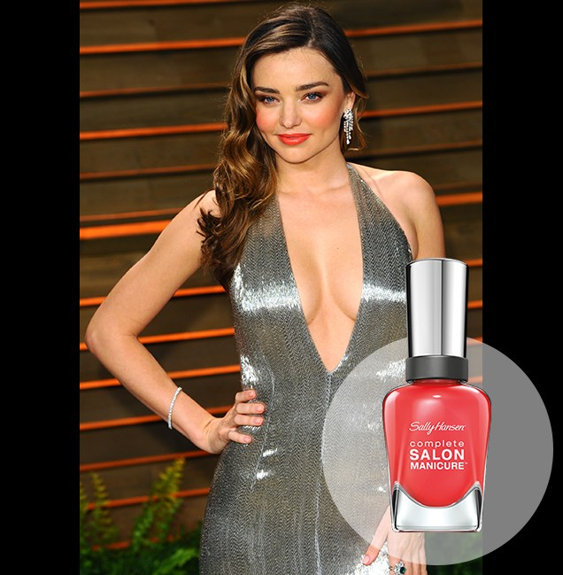 "Striking a pose at the Vanity Fair Oscars Party: Miranda Kerr fires up her silver gown with coral lips and peach blush. <p> <em>Kook A Mango, RRP $14.95</em><br> <a href=""http://en-au.sallyhansen.com/en-au/products/nails/nail-color/complete-salon-manicure-0"" target=""_blank"">Find your colour match from the Complete Salon Manicure Range.</a>"