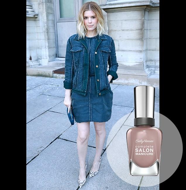 """Kate Mara offsets a dark denim dress with pale mauve lips at the Louis Vuitton show as part of Paris Fashion Week. <p> <em>Mauve Along, RRP $14.95</em><br> <a href=""""http://en-au.sallyhansen.com/en-au/products/nails/nail-color/complete-salon-manicure-0"""" target=""""_blank"""">Find your colour match from the Complete Salon Manicure Range.</a>"""